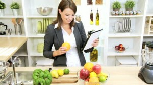 stock-footage-smiling-young-businesswoman-using-wireless-tablet-to-find-recipes-for-fresh-organic-produce